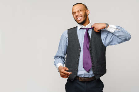 Young adult afro american businessman with tired and sick expression studio shot
