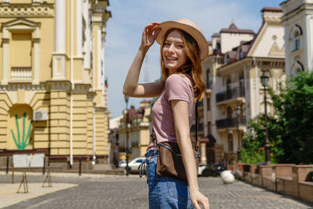 Beautiful Young Woman tourist Pleasant walk in the City Center