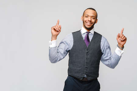 African-American businessmanman showing up by finger over grey background