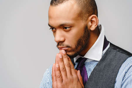 African american man holding hands in prayer hoping for better Banque d'images