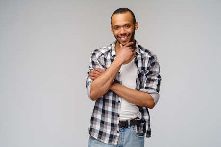 african-american young man wearing casual shirt over light grey background