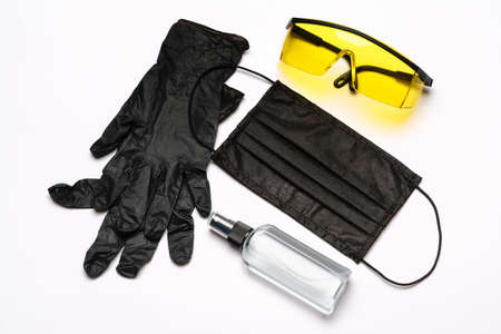Safety equipment to fight to Coronavirus COVID-19 virus outbreak - Safety mask, hand sanitizer, latex gloves and protective glasses or goggles Standard-Bild - 157341369