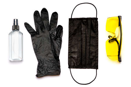 Safety equipment to fight to Coronavirus COVID-19 virus outbreak - Safety mask, hand sanitizer, latex gloves and protective glasses or goggles