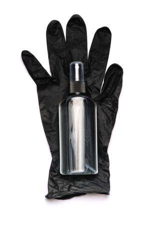 Safety equipment to fight to Coronavirus COVID-19 virus outbreak - hand sanitizer and latex gloves Standard-Bild - 157341394