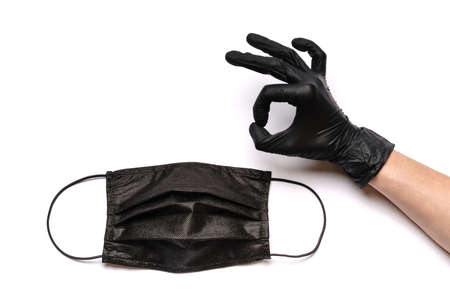 Human hand in protective glove and face protective masks isolated on white background Standard-Bild