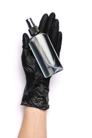 Human hand in protective glove holding alcohol hand sanitizer spray isolated on white background Standard-Bild - 157341428