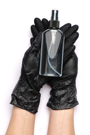 Human hand in protective glove holding alcohol hand sanitizer spray isolated on white background