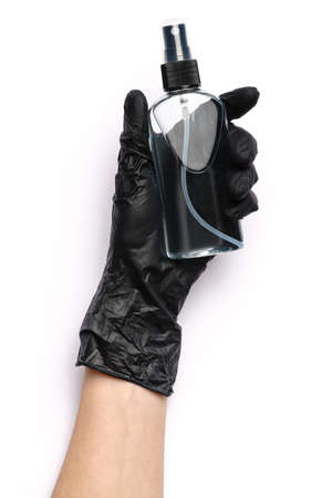 Human hand in protective glove holding alcohol hand sanitizer spray isolated on white background Standard-Bild - 157341432