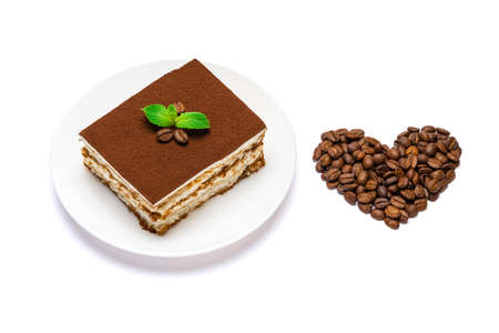 Traditional Italian Tiramisu square dessert portion on ceramic plate and heart shape made of coffee beans isolated on white background with clipping path