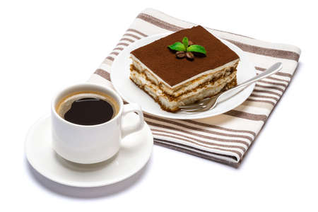 Traditional Italian Tiramisu dessert square portion on ceramic plate and cup of fresh espresso coffee isolated on white background with clipping path Standard-Bild