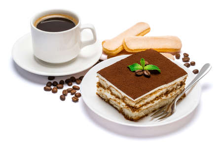 Traditional Italian Tiramisu dessert square portion on ceramic plate, savoiardi cookies and cup of fresh espresso coffee isolated on white background with clipping path Standard-Bild