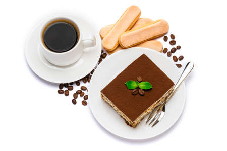 Traditional Italian Tiramisu dessert square portion on ceramic plate, savoiardi cookies and cup of fresh espresso coffee isolated on white