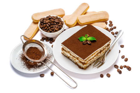 Traditional Italian Tiramisu dessert square portion on ceramic plate and savoiardi cookies isolated on white background