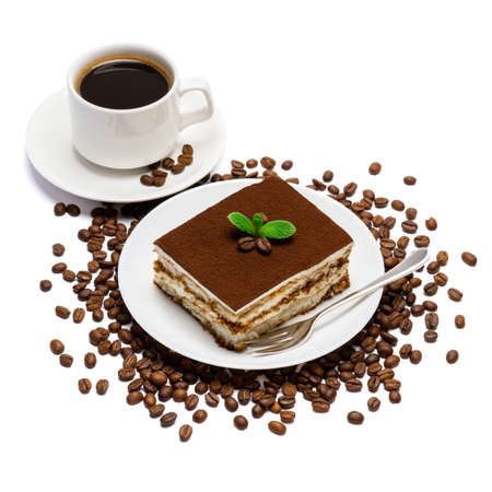Traditional Italian Tiramisu dessert square portion on ceramic plate and cup of fresh espresso coffee isolated on white Standard-Bild
