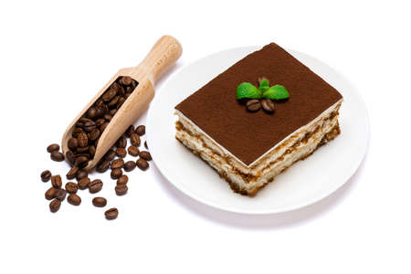 Traditional Italian Tiramisu square dessert portion on ceramic plate and coffee beans isolated on white background with clipping path