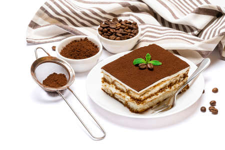 Traditional Italian Tiramisu dessert square portion on ceramic plate and savoiardi cookies isolated on white