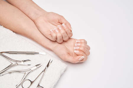 Top view of Tools of a manicure set on a white background