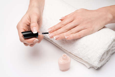 Woman making manicure by herself on grey background Archivio Fotografico