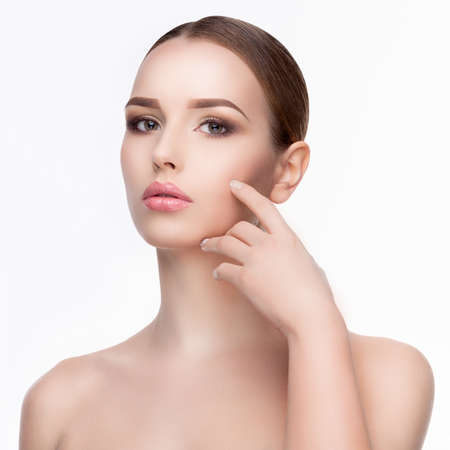 Beauty Portrait of Young Woman with Perfect Clean Fresh Skin close up isolated on white background - Skin Care Concept.. Stock fotó