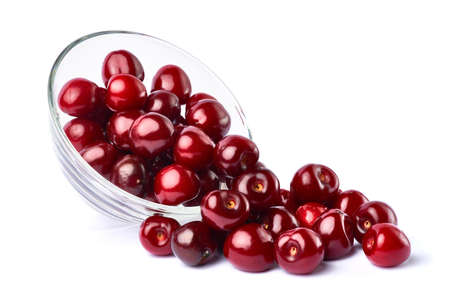 glass bowl of sweet cherry fruits isolated on white background Stock fotó