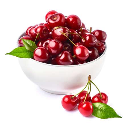 white caeramic bowl of sweet cherry fruits isolated on white background