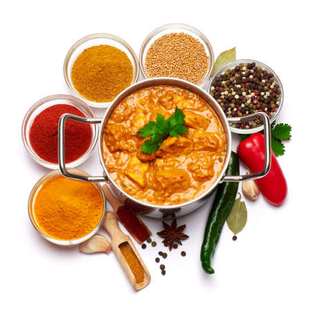 Pot of Traditional Chicken Curry and set of spices on white background