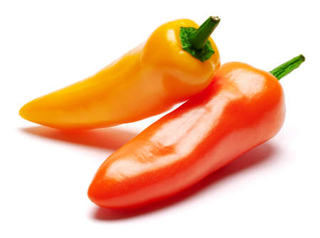 Two Chili or sweet peppers isolated on white background