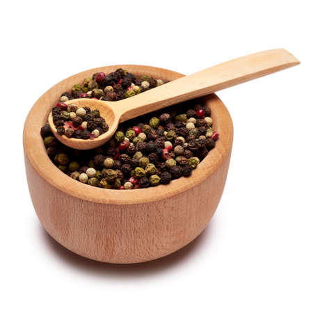 black round pepper spice in wooden bowl or mortar on white background