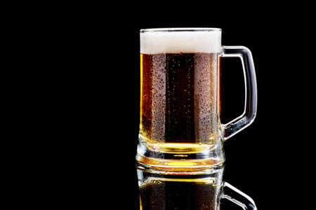Studio shoy of Mug with beer on dark background Standard-Bild