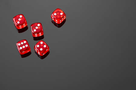 Red casino dice isolated over black reflective background Stock Photo