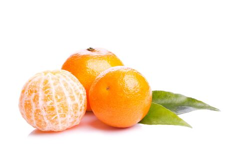 orange peel clove: Three fresh mandarin fruit on white background
