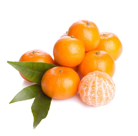 orange peel clove: Pile sweet tangerines fruit on white background