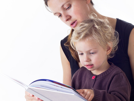 three years old: mother and three years old daughter reading a book