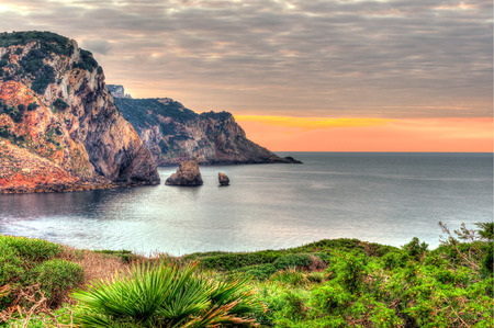 hdri: Landscape of coast of Sardinia with green grass in foreground and sea in background