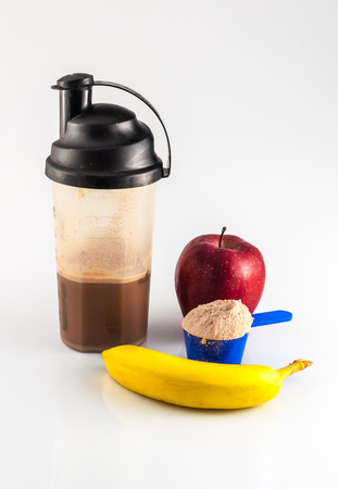 muscle gain: post workout meal with whey protein, shaker, banana and apple