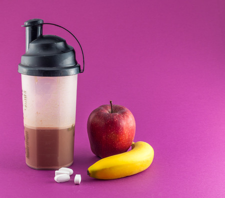 whey: post workout meal with whey protein, shaker, banana and apple
