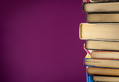 backgruond: A pile of old books on a colored backgruond Stock Photo
