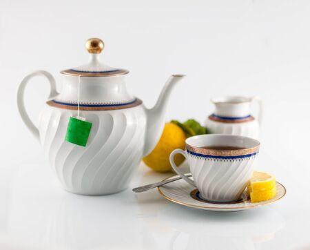 tea service: closeup of old tea service with cup, teapot,and milk jug