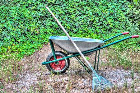 hdri: hdr of wheelbarrow in a garden and a rake