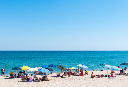 crowded beach of platamona, in the gulf of asinara - sardinia