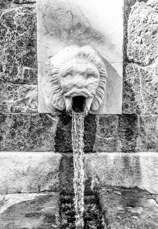 italian fountain: Ancient fountain in the middle of italian city