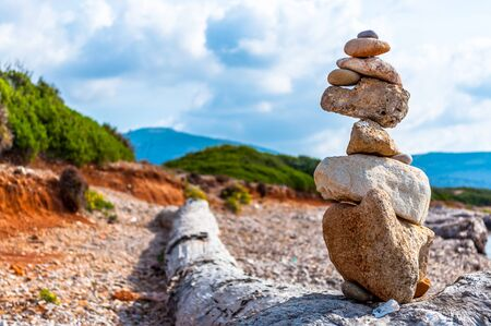 Pile of stones on the sea in a sunny day of autumn Stock Photo