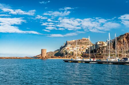 View of ancient villageof Castelsardo - Sardinia  from the harbor in a suny day Foto de archivo