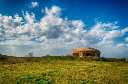 World war two bunker in the country under a dramatic sky Stock Photo