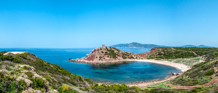 Panoramic landscape of Porticciolo ancient tower in a sunny day of spring Banco de Imagens