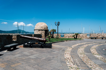 ancient cannons on the ramparts of Alghero ina  sunny day of spring