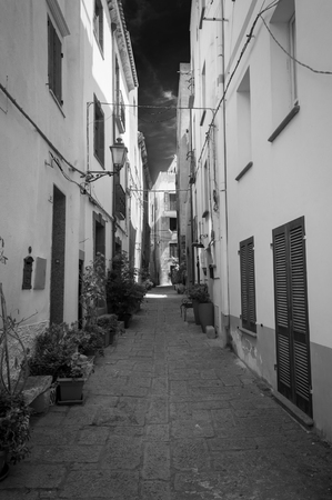 the beautiful alley of castelsardo old city - sardinia - italy in infrared black and white