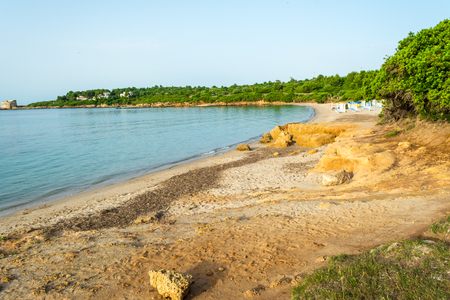 View of sardinian beach of Lazzaretto, near the city of Alghero, in the early morning