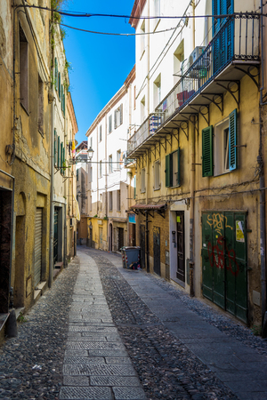 Beautiful deserted alley in a italian old city in a sunny day Reklamní fotografie