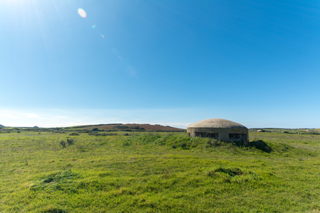 world war II bunker in a meadow near the beach in north of sardinia